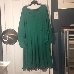 Gorgeous green dress with feminine ruffles